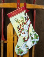 Chaussette de Noël : les bonhommes de neige en traîneau