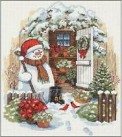 Bonhomme de neige à la cabane